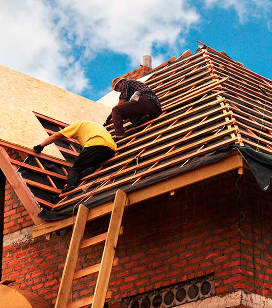 Roofing Contractors Installing House Roof Board