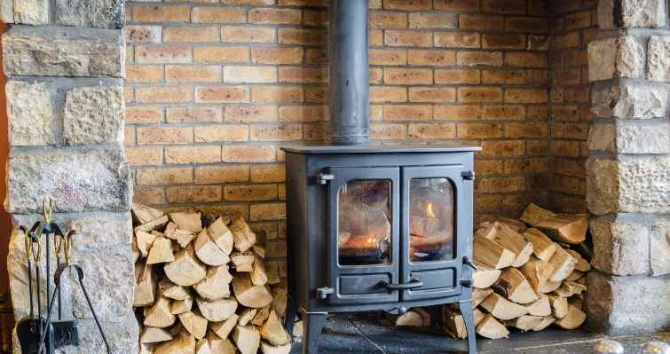 why wood burning stoves are better than normal chimneys